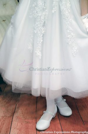 tulle first communion dress with heavy beading