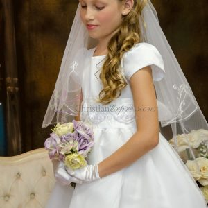 White first communion dresses with large rosettes