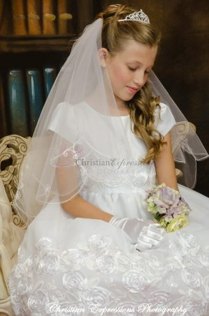 first communion dress with large rosettes